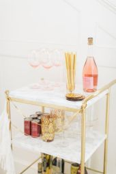 this is the bar cart I have from Ikea...though the marble contact paper + gold paint is definitely an upgrade!